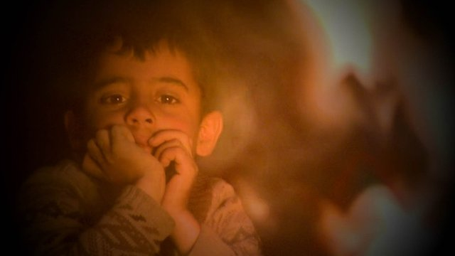 small boy in refugee camp