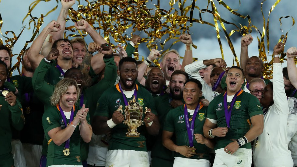 South Africa's Springboks celebrate after being handed the World Cup trophy