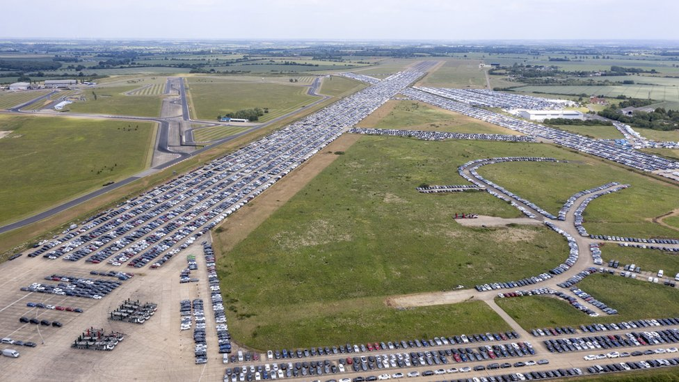Aerial view of cars being stored on airport runways