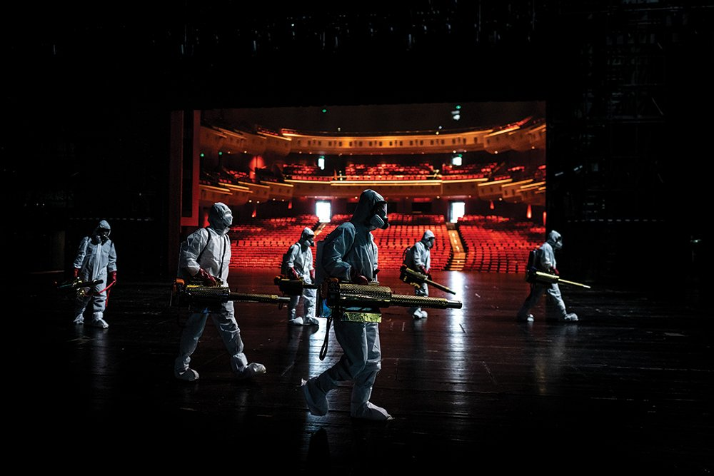 Volunteers disinfect the Qintai Grand Theatre, Wuhan