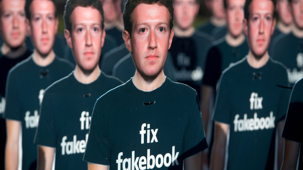 photo of Mark Zuckerberg posters from an Anti-Facebook protest