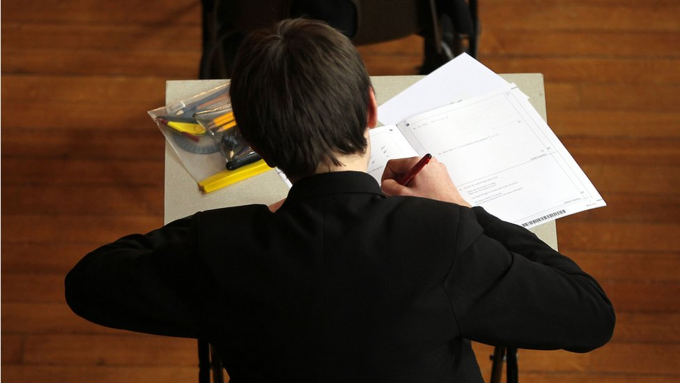 A school pupil taking an exam