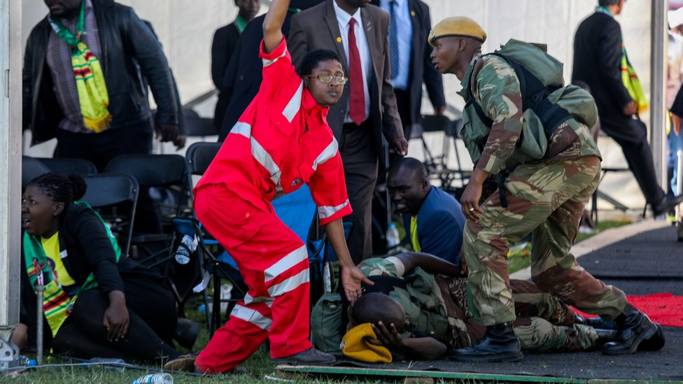 Medics attend to people injured in an explosion during a rally by Zimbabwean President Emmerson Mnangagwa in Bulawayo