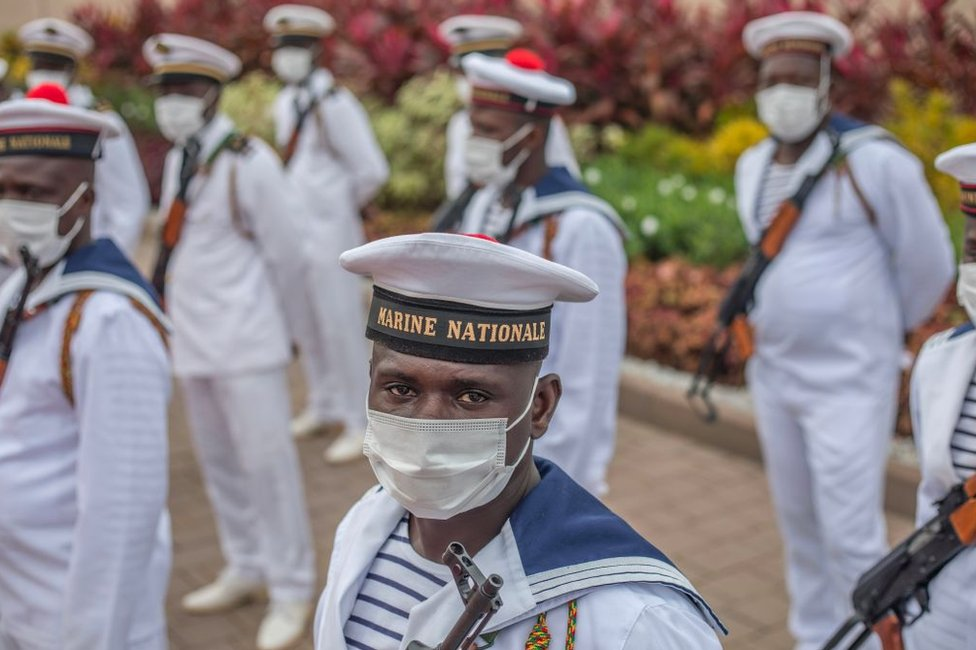 Naval officers await the arrival of President Patrice Talon at the Palais de la Marina.