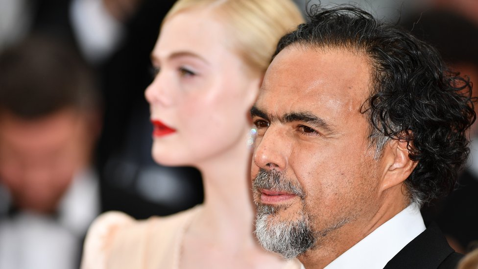 Alejandro González Iñárritu and Elle Fanning arrive for the screening of the film The Dead Don't Die and the Opening Ceremony at the 72nd annual Cannes Film Festival in Cannes, 14 May 2019