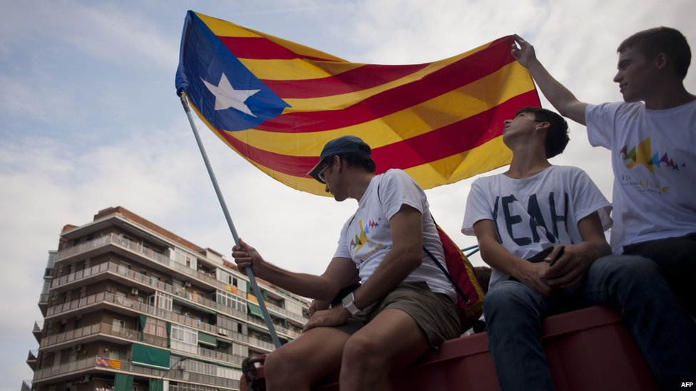 """Demonstrators gather on Meridiana street as they wave """"Estelada"""" flags (pro-independence Catalan flags) during celebrations of Catalonia""""s National Day"""