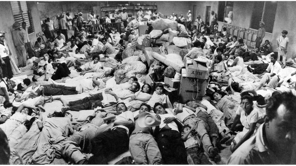 Salvadoran migrants at a Red Cross post