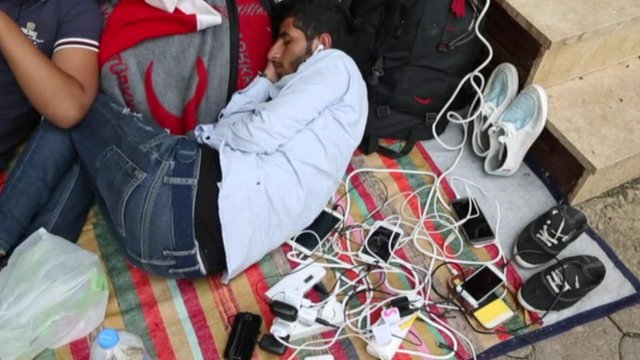 Refugees charging phones