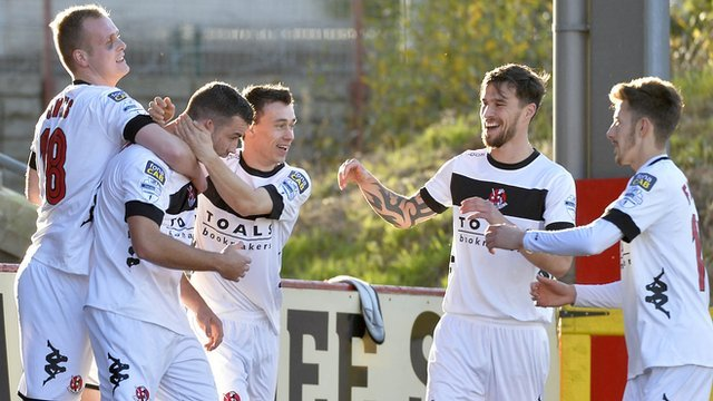 Crusaders players celebrate taking the lead against Portadown
