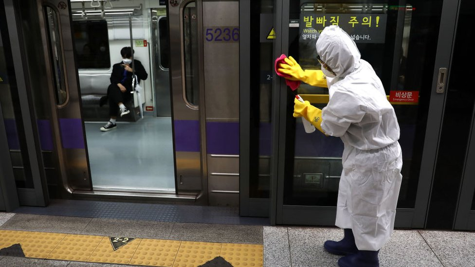 A worker sprays anti-septic solution at a subway in Seoul, South Korea