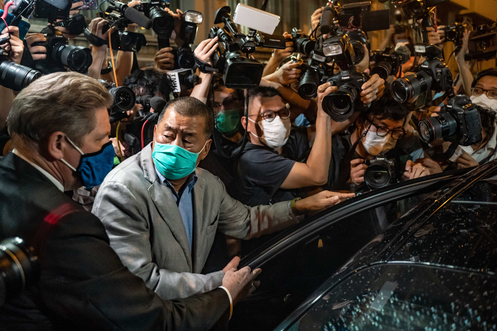 Hong Kong pro-democracy media tycoon Jimmy Lai surrounded by photographers