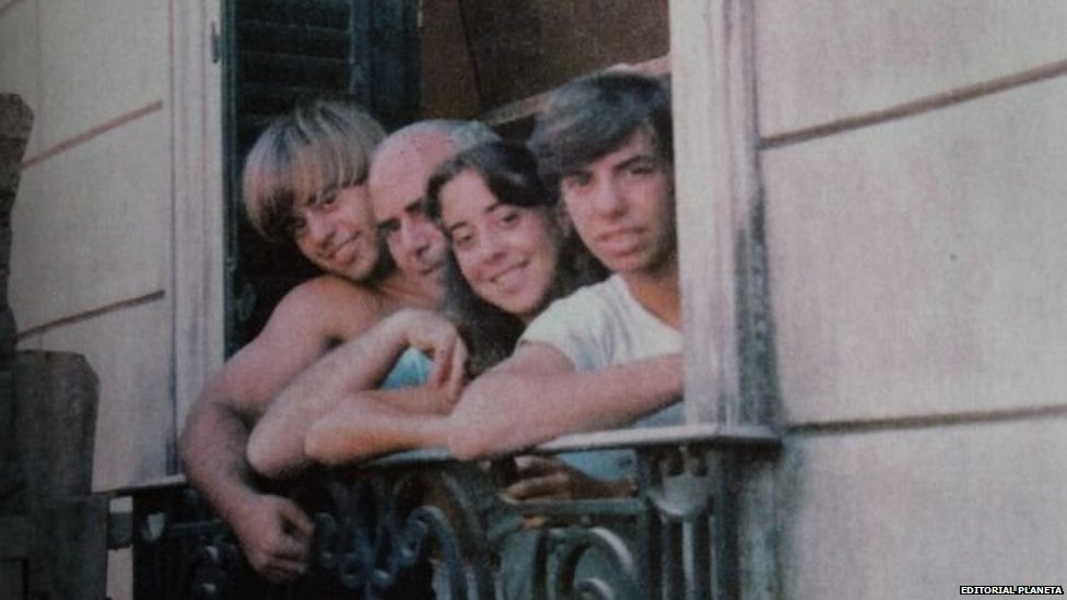 Daniel, Arquimedes, Silvia and Guillermo Puccio look from a window in this undated file photo