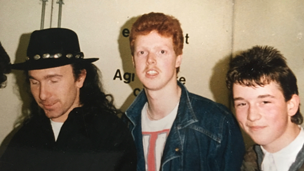 U2 fan Paul Duffy (centre) with U2's The Edge (left) and a friend in Belfast, March 1987