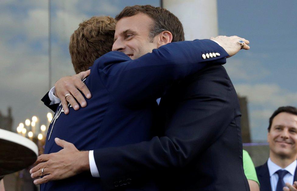 Macron hugging Elton John