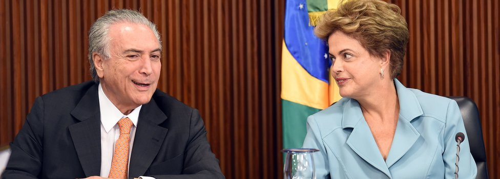 Brazilian President Dilma Rousseff (R) gestures next her Vice President Michel Temer in 2015