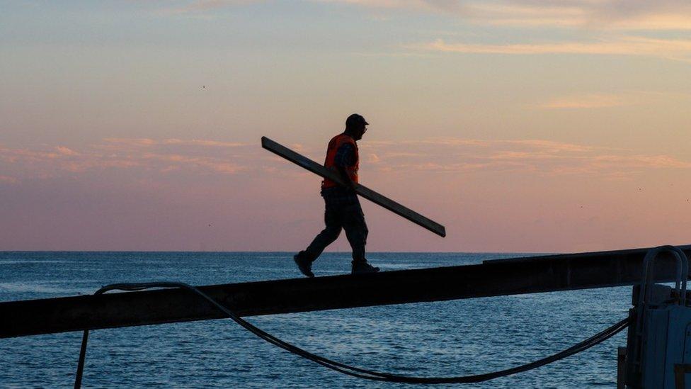 Man boarding a boat