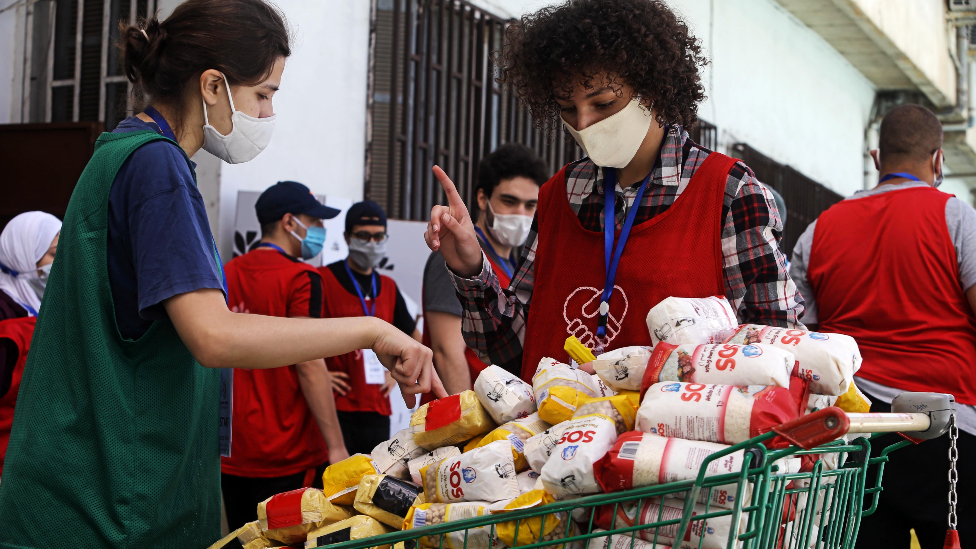 A group of young volunteers prepare food aid in Algiers, Algeria - May 2020