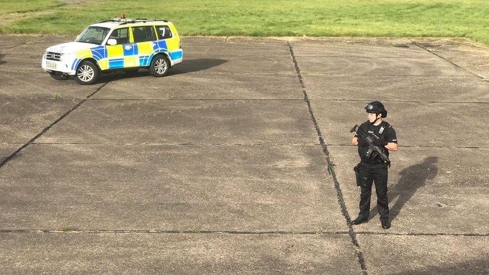 Police officer near plane