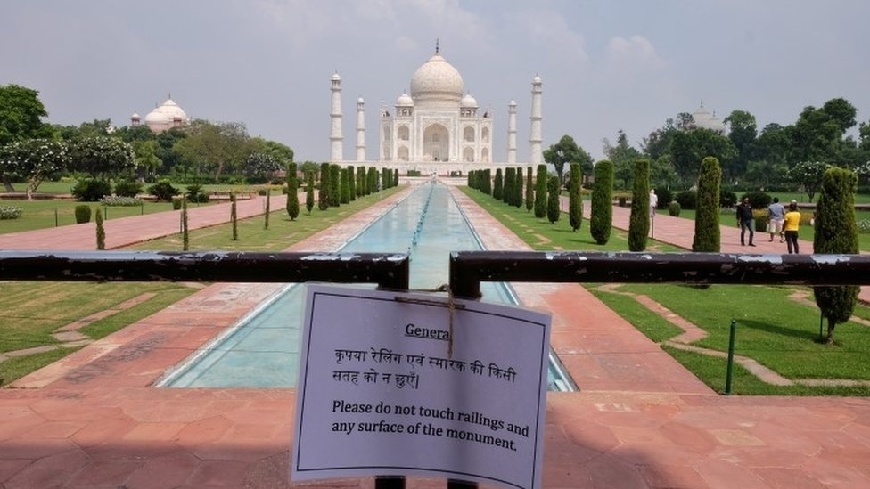 A notice is tied to a railing inside the premises of Taj Mahal after authorities reopened the monument for visitors,