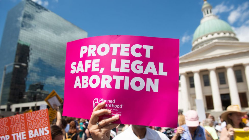 Protesters hold signs as they rally in support of Planned Parenthood and pro-choice and to protest a state decision that would effectively halt abortions by revoking the center's license to perform the procedure, near the Old Courthouse in St. Louis, Missouri, May 30, 2019