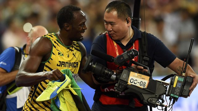 Bolt laughs with the cameraman after the fall
