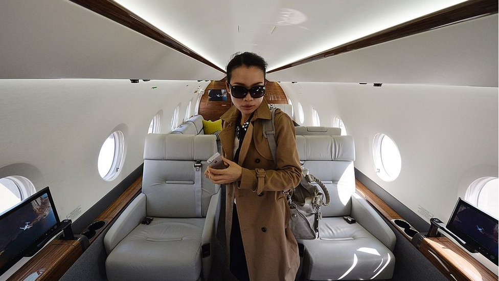 A Chinese woman on a luxury jet