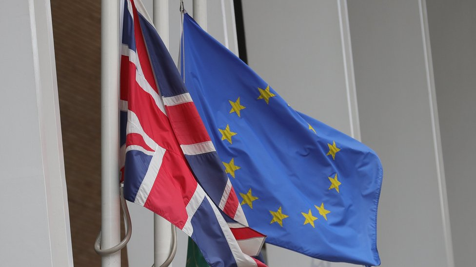 UK and EU flags fly at half mast outside the Shangri-La Hotel at The Shard in London