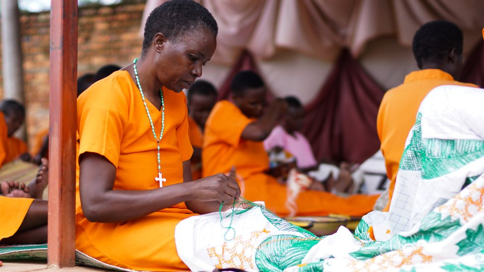 A woman in prison sewing