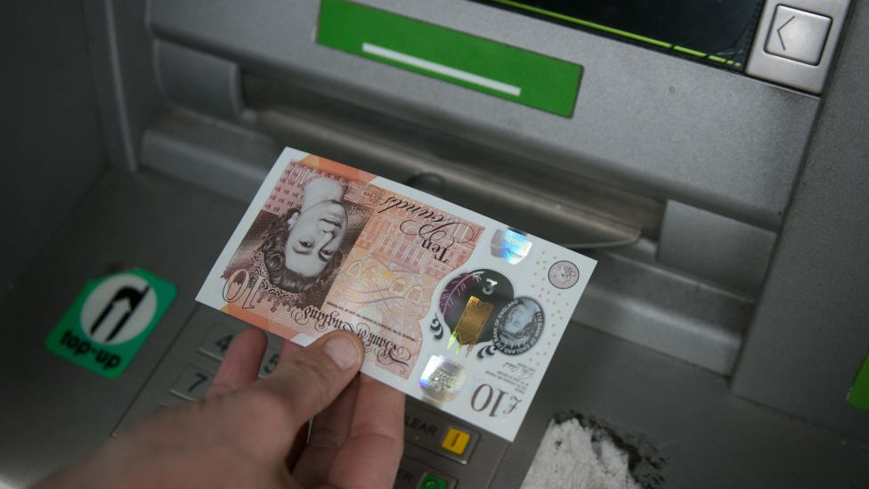 Cash being withdrawn from ATM
