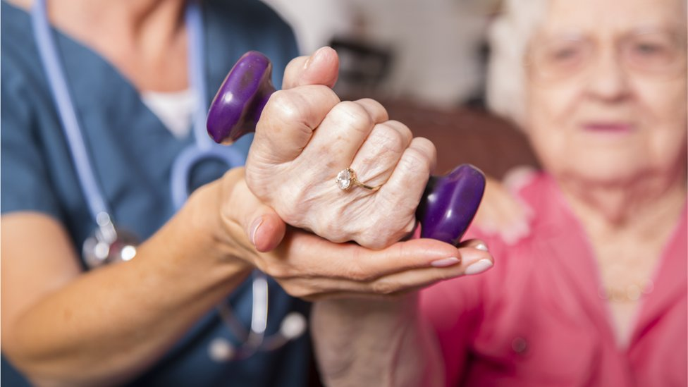 Elderly woman receiving physiotherapy