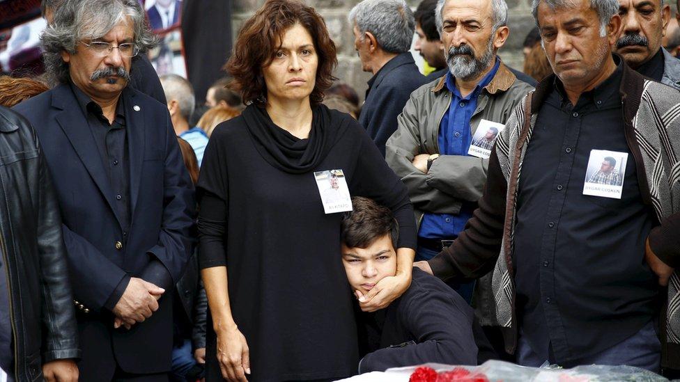 Emel Kitapci (2nd L) and Artun Siyah Kitapci, the wife and son of Ali Kitapci, a victim of Saturday's bomb blasts, attend a commemoration in Ankara, Turkey, October 12, 2015.