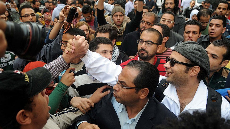 Ahmed Maher (right) at a protest in Cairo on 30 November 2013