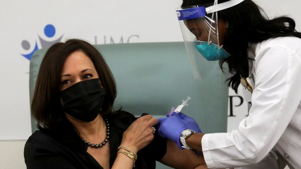 Vice President-elect Kamala Harris receives a dose of the Moderna vaccine at United Medical Center in Washington, DC