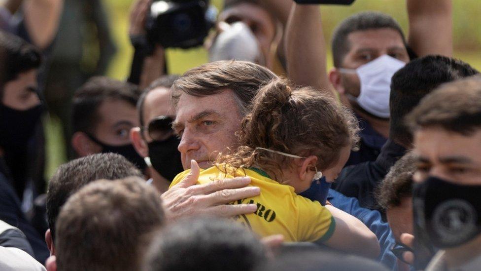 Brazilian president Jair Bolsonaro meets supporters during a demonstration, in Brasilia, Brazil, 24 May 2020.