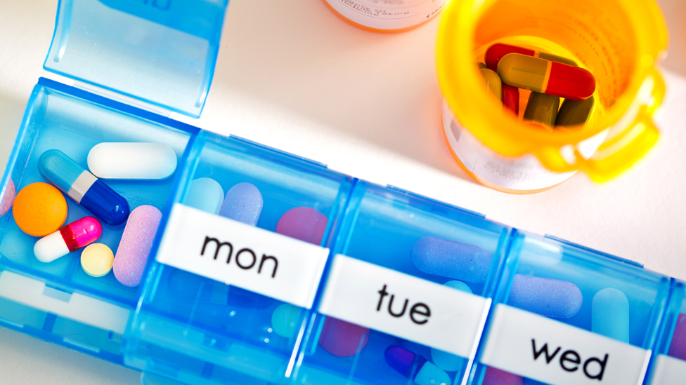 A pill box and pills