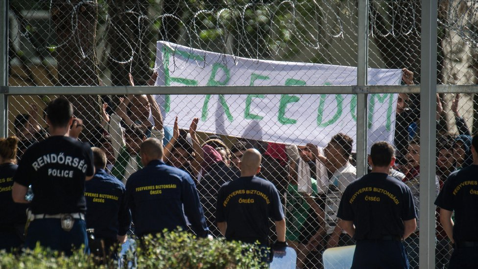 """Migrants chant the slogan """"Freedom"""" as they protest demanding better conditions and faster administrative process deciding about their asylum claim"""