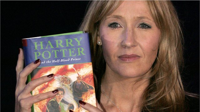 JK Rowling holding Harry Potter and the Half-Blood Prince