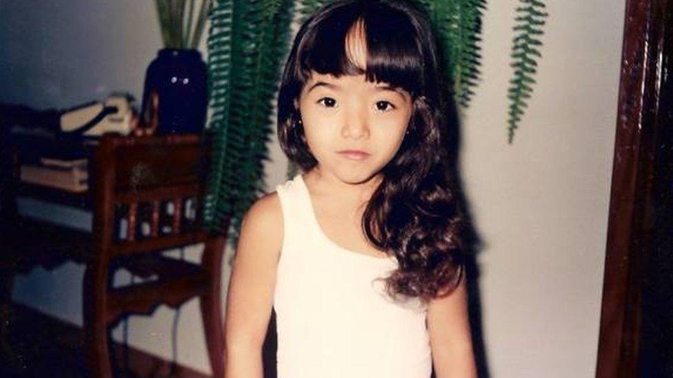 Ana Carolina Caceres as a child
