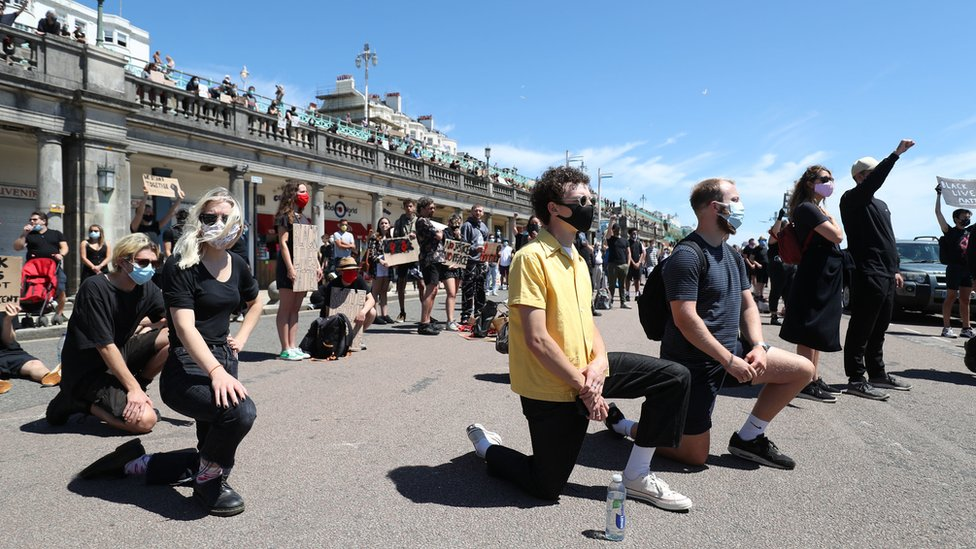 Protesters from Black Lives Matter took part in a silent vigil on Brighton Pier