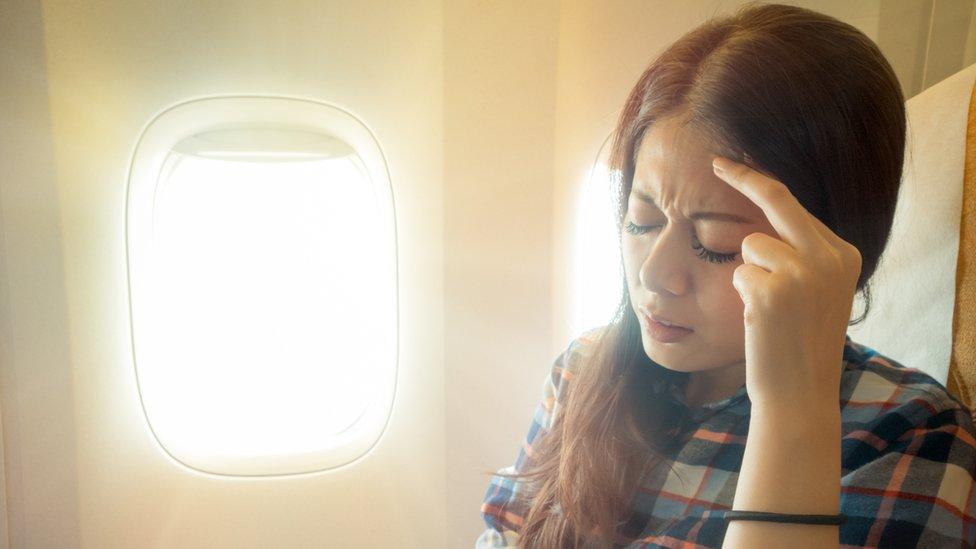 žena u avionu