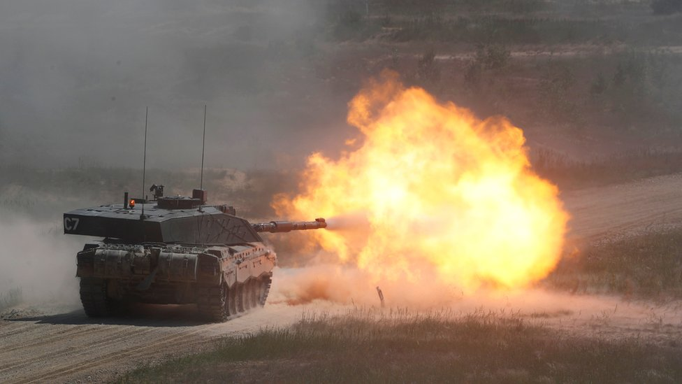 A tank fires with a flaming blast from the cannon caught on camera in this photo