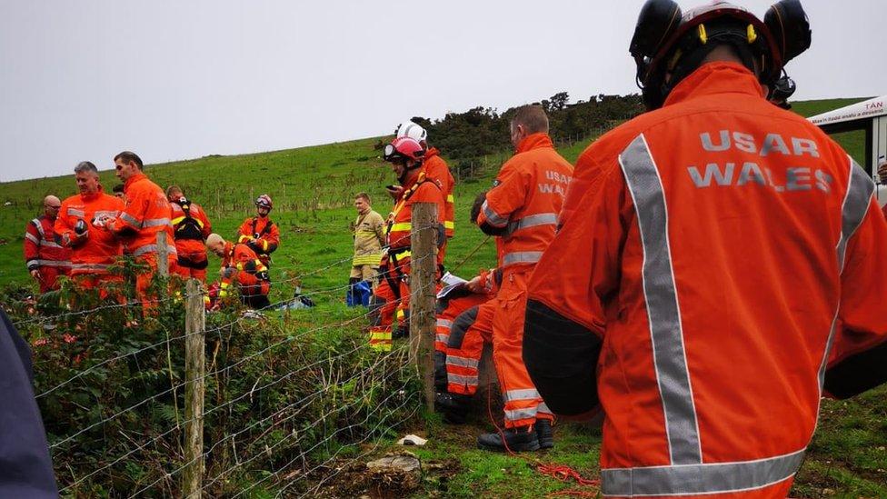 Fire crews around the mine shaft