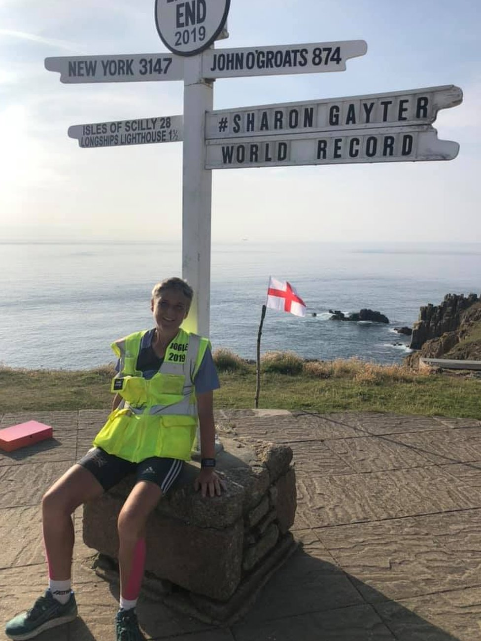 Sharon Gayter under the Land's End location sign