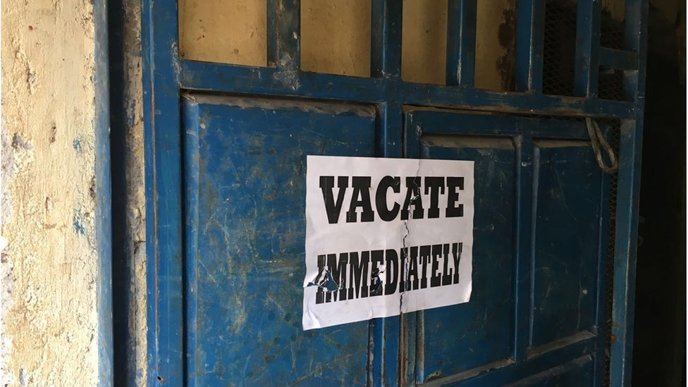 Vacate Immediately sign on door of house to be demolished in Harama, Nairobi, 6 May 2016