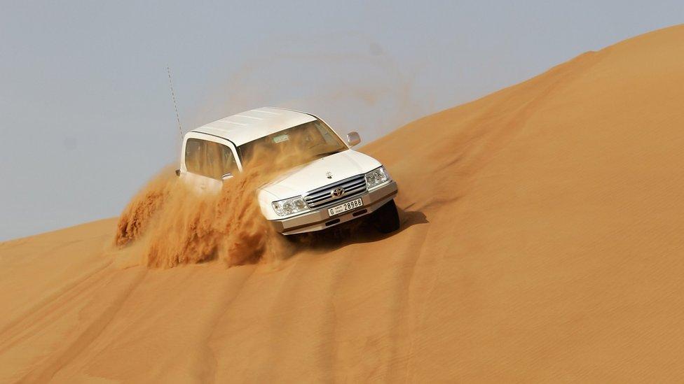 """File photo: A car """"dune bashing"""" in Dubai, 28 March 2006"""