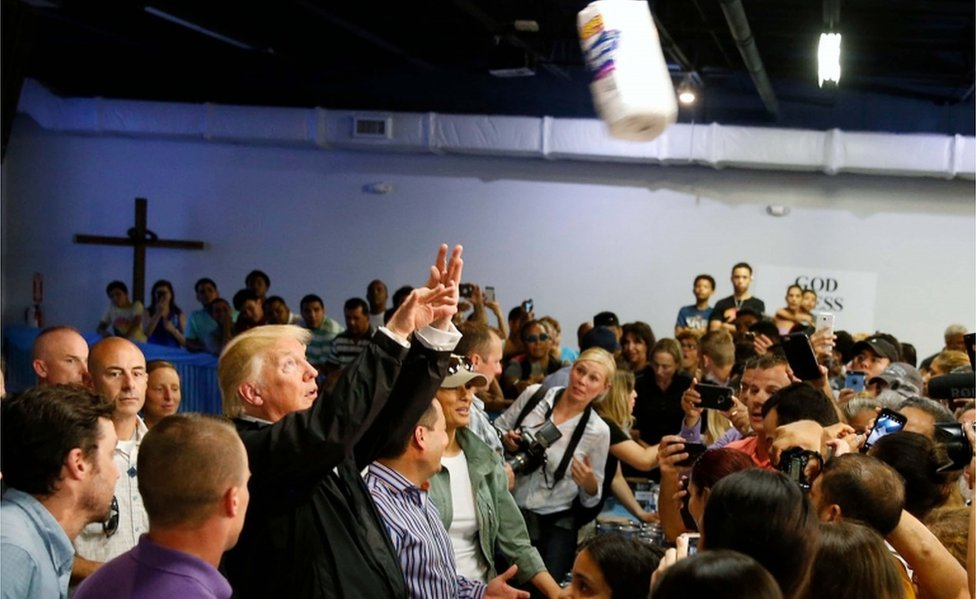 Trump tosses rolls of paper towels into the crowd