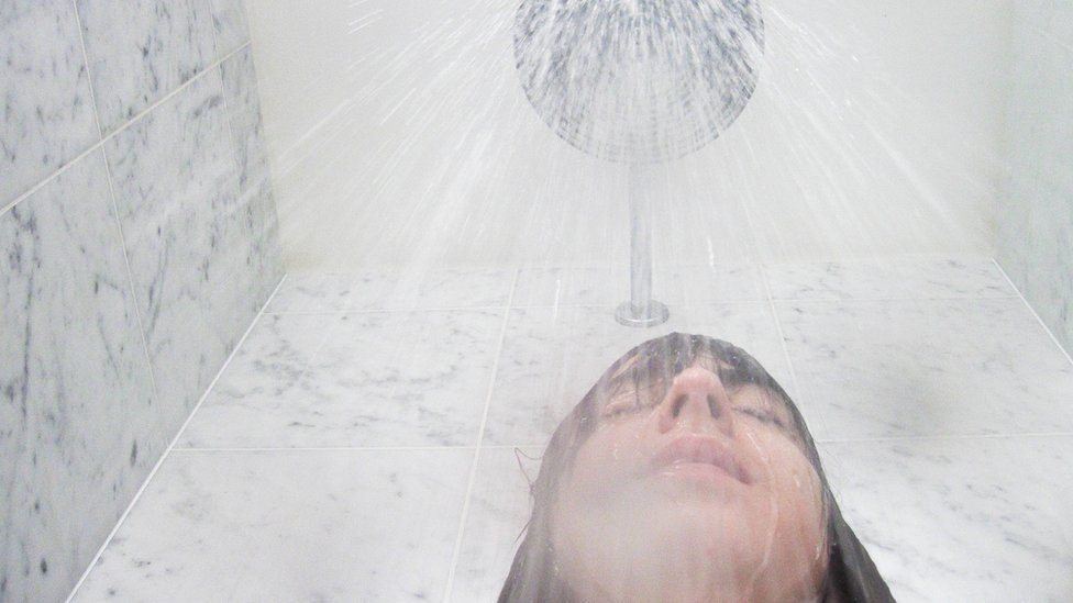 Woman under the shower head