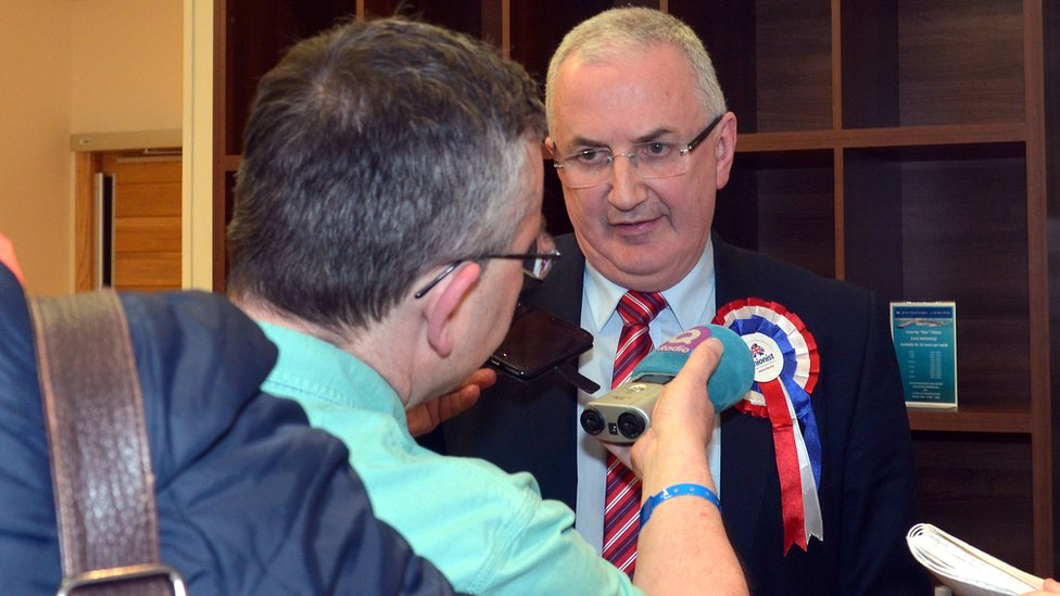 Danny Kennedy, UUP, speaks to the media following his defeat