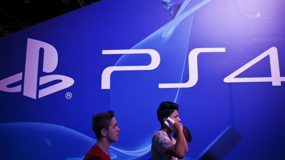 PlayStation logo and two people walking.