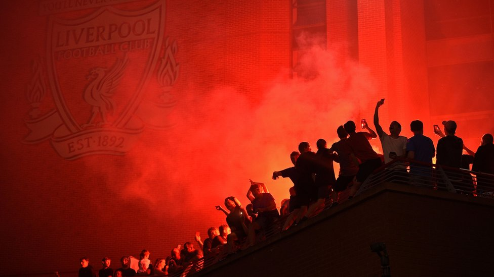 Liverpool fans celebrate outside Anfield